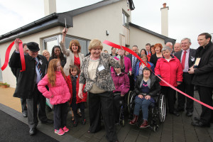 Tanaiste Joan Burton cuts the ribbon to officially open 11 Blackbog Grove